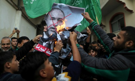 Palestinians burning a poster of Lieberman