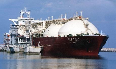 A Qatari liquid natural gas (LNG) tanker ship being loaded up with LNG at Raslaffans Sea Port, north