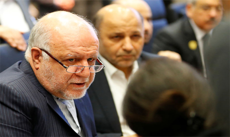 Iran's Oil Minister Bijan Zanganeh talks to journalists at the beginning of an OPEC meeting in Vienna Austria