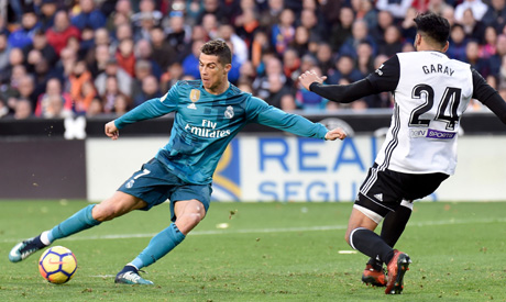 Real Madrid s Portuguese forward Cristiano Ronaldo (L) vies with Valencia s  Argentinian defender Ezequiel Garay during the Spanish league football  match ... 156dcc6db