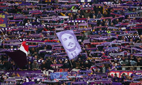 Fiorentina fans with a banner of former player Davide Astori before the match  (Reuters)