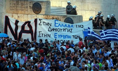 Pro-Euro protestors gather on Constitution (Syntagma) square in front of the parliament building, in