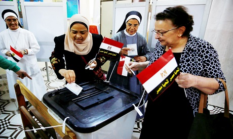 Egyptians cast their votes at a polling station during the presidential election 2018