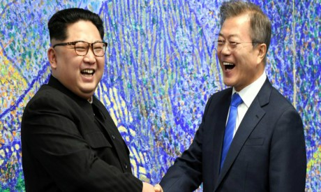 South Korean President Moon Jae-in shakes hands with North Korean leader Kim Jong Un during their me