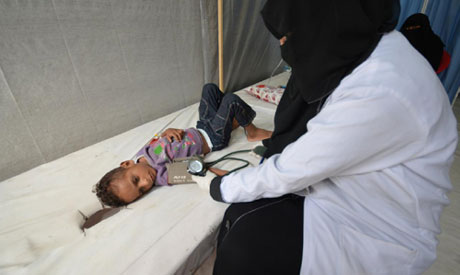 FILE PHOTO: A nurse attends to a boy infected with cholera at a hospital in the Red Sea port city of