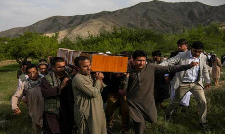Relatives and friends of AFP Afghanistan Chief Photographer Shah Marai Faizi, carry his coffin befor