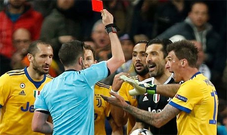 UEFA charge Gianluigi Buffon over referee Michael Oliver outburst