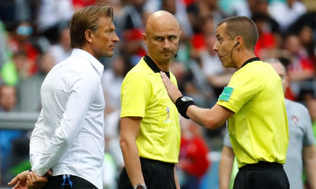 Morocco coach Herve Renard remonstrates with referee Mark Geiger REUTERS