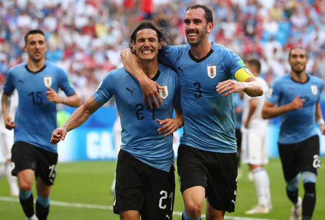 PHOTO GALLERY: Uruguay beat Russia to go top of Group A