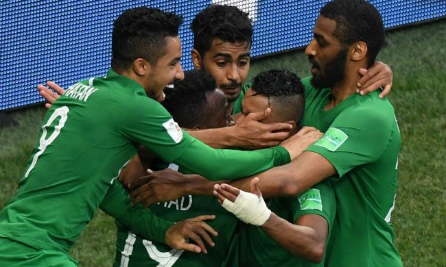 Saudi players celebrate their winning goal (Afp)
