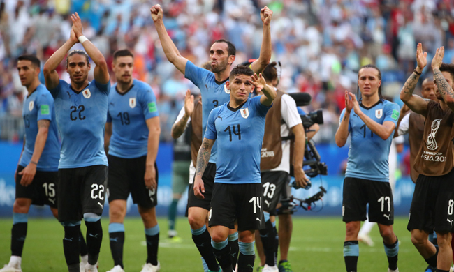 Torreira celebrates with teammates after the match (Reuters)