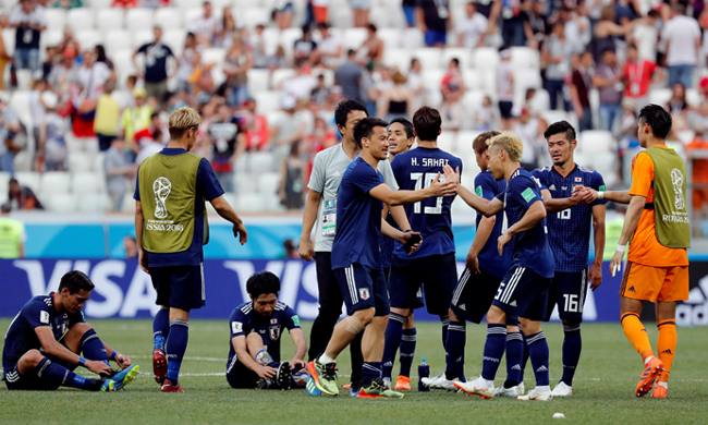 Japan players celebrate after the match (Reuters)