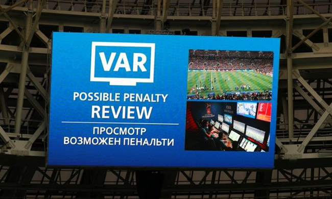 General view of the scoreboard showing a possible penalty review by VAR