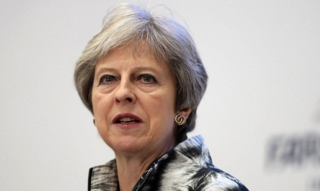 UK's May halts revolt over Brexit trade bill