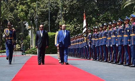 Egyptian President Abdel Fattah El-Sisi with his Yemeni counterpart Abd Rabo Mansour Hadi during his