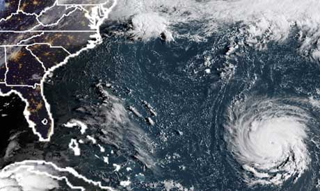 "Hurricane Florence is expected to become a dangerous ""major hurricane"" by late Monday as it heads to"