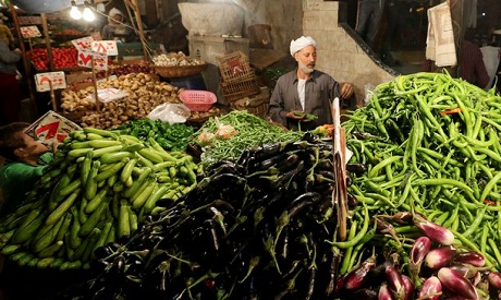 An Egyptian vegetable seller is seen at a market in Cairo, Egypt, December 10, 2018 (Photo:Reuters)
