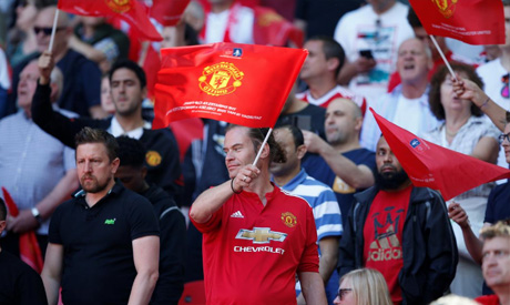 Manchester United fan waves a flag before the match (REUTERS)