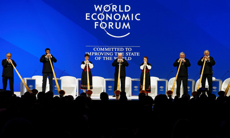 Musicians play alphorns during the official opening ceremony of the World Economic Forum (WEF) annua