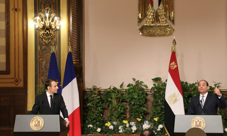 Egyptian President Abdel Fattah al-Sisi (R) and his French counterpart Emmanuel Macron hold a joint