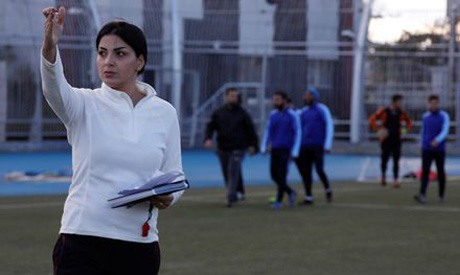 Maha Jannoud, 32, coaches during a training for al-Muhafaza Sports club men