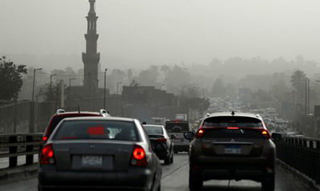 Cars sit in traffic on El Sayeda Aisha Bridge during a sandstorm in Cairo (Reuters)