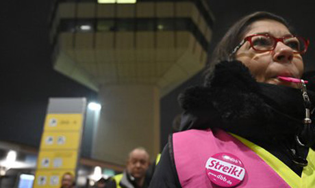 Security staff attend a four-hour strike at Berlin
