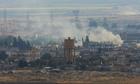 Smoke rises over the Syrian town of Ras al-Ain