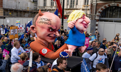 Prime Minister Boris Johnson as a puppet operated by his advisor Dominic Cummings