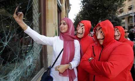 Lebanese protesters pose for a picture during a rally in downtown Beirut on the third day of demonst