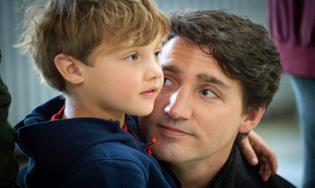 Leader of the Liberal Party of Canada, Justin Trudeau holds his son as he votes