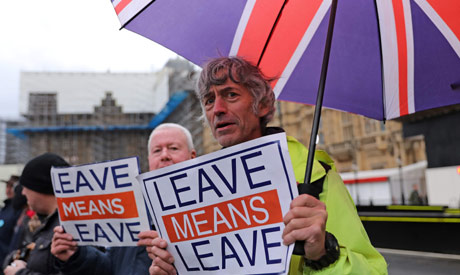 Pro-Brexit activists demonstrate outside of the Houses of Parliament in central London on October 21