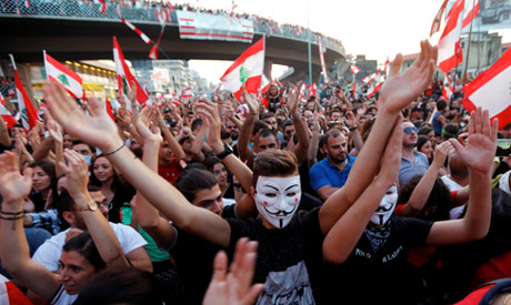 Demonstrators carry national flags and gesture during an anti-government protest along a highway in