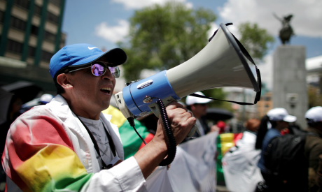 Doctors and health employees march in protest against Bolivia's President Evo Morales