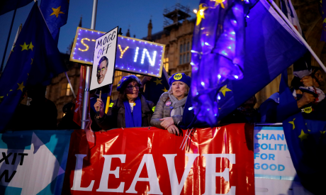 Banners, Union and EU flags are displayed outside the Houses of Parliament in London