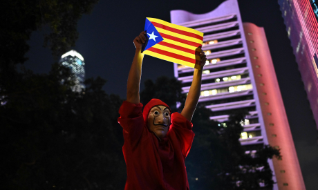 "A protester holds a Catalan pro-independence ""Estelada"" flag during the Hong Kong-Catalonia solidari"
