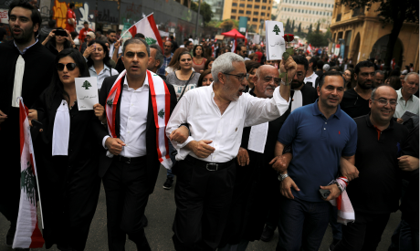 Lebanese judges and judicial employees shout slogans as they take part in ongoing anti-government pr