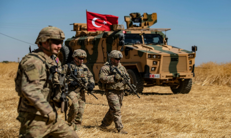 US troops & Turkish military vehicle