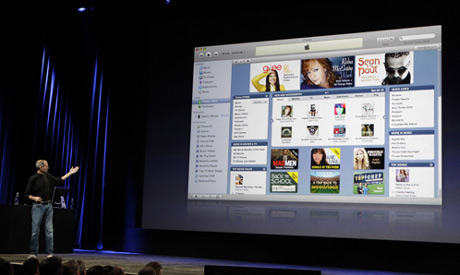 FILE - In this Sept. 9, 2009, file photo Apple CEO Steve Jobs talks about iTunes at an Apple event i
