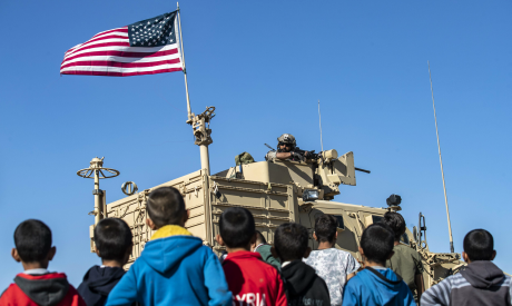 Children stare at a US soldier