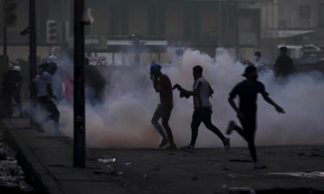 Iraqi security forces fire tear gas to disperse anti-government protesters