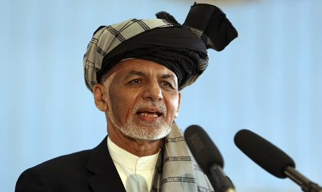 In this Sept. 28, 2019, file photo, Afghan President Ashraf Ghani speaks to journalists after voting
