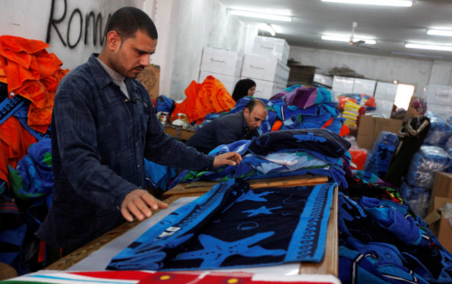 FILE PHOTO: Labourers work at a textile mill in Al-Mahalla al-Kubra, about 110 km north of Cairo Mar