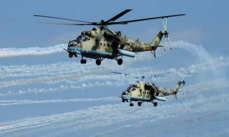 Russian Mi-35 helicopters fire during military exercises in Dagestan, Russia (Reuters)