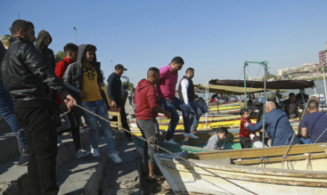 People cross the Tigris River