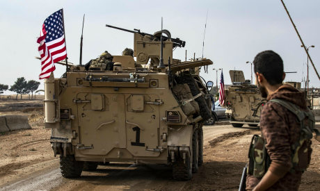 US troops drives by in the Kurdish-majority city of Qamishli