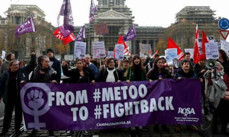 Protesters attend a demonstration against all kinds of violence towards women