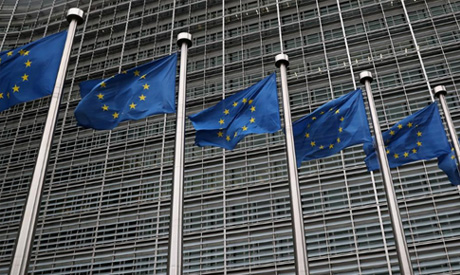 European Union flags fly outside the European Commission headquarters in Brussels, Belgium. AFP