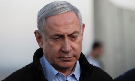 Israeli Prime Minister Benjamin Netanyahu visits an Israeli army base in the Israeli-occupied Golan