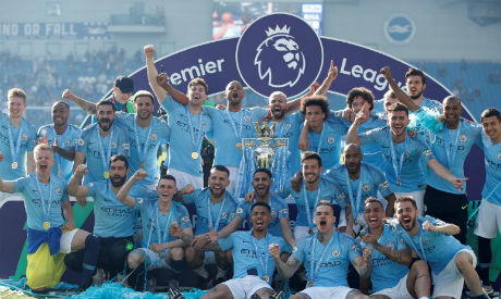 FILE PHOTO: Manchester City players (Reuters)